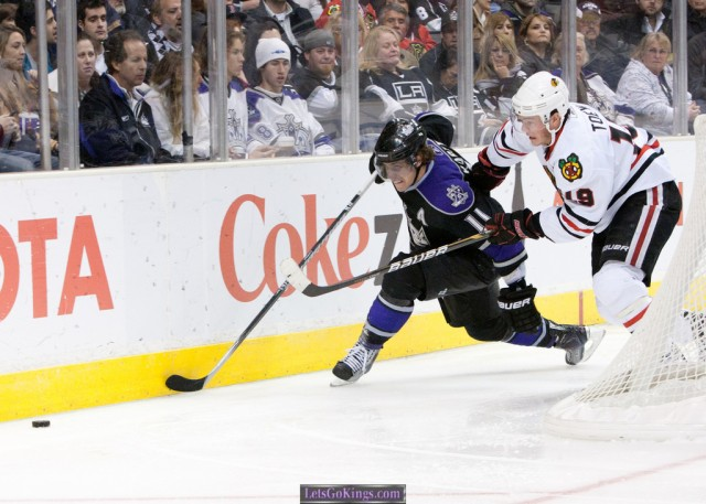Anze Kopitar and Jonathan Toews battle for the puck and the Western Conference